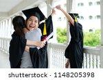 hugging her friend student in... | Shutterstock . vector #1148205398
