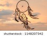 dream catcher on the sunset... | Shutterstock . vector #1148207342