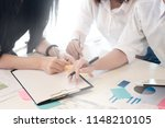 closeup meeting of finance with ... | Shutterstock . vector #1148210105