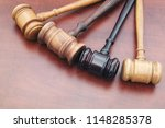 many judge gavels on table ... | Shutterstock . vector #1148285378
