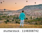 young man watching sunrise in... | Shutterstock . vector #1148308742