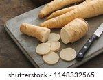 preparing racine root parsley | Shutterstock . vector #1148332565
