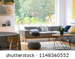 pouf next to table in modern... | Shutterstock . vector #1148360552