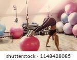 girl in sportswear training on... | Shutterstock . vector #1148428085
