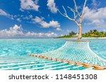 romantic cozy hammock in blue... | Shutterstock . vector #1148451308