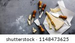 parmesan cheese and knife on... | Shutterstock . vector #1148473625