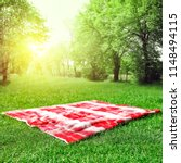 red and white empty blanket on... | Shutterstock . vector #1148494115