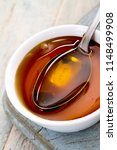 refined golden sugar syrup in... | Shutterstock . vector #1148499908
