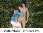 happy stylish couple lying in...   Shutterstock . vector #1148521598