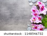 orchid and spa stones on a... | Shutterstock . vector #1148546732