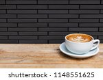 a beautiful cup of cappuccino... | Shutterstock . vector #1148551625