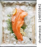 salmon steak on ice with dill... | Shutterstock . vector #1148553842
