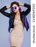 fashion portrait of a young... | Shutterstock . vector #1148569202