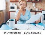elderly woman looking at her... | Shutterstock . vector #1148580368