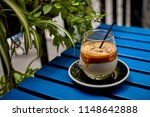 iced coffee latte on the blue... | Shutterstock . vector #1148642888