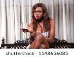 pretty ebony model sitting on a ... | Shutterstock . vector #1148656085