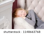 a young girl in the next to the ... | Shutterstock . vector #1148663768