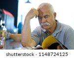senior man hangout in a bar | Shutterstock . vector #1148724125