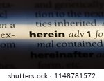 Small photo of herein word in a dictionary. herein concept.