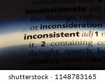 Small photo of inconsistent word in a dictionary. inconsistent concept.
