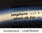 Small photo of implore word in a dictionary. implore concept.