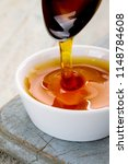 refined golden sugar syrup in... | Shutterstock . vector #1148784608