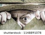 a curious neighbor looks over a ... | Shutterstock . vector #1148891078