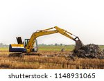 excavator backhoe working in... | Shutterstock . vector #1148931065