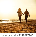 summer time on beach and two... | Shutterstock . vector #1148977748
