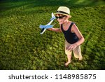 teenager playing with a plane | Shutterstock . vector #1148985875