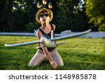 teenager playing with a plane | Shutterstock . vector #1148985878