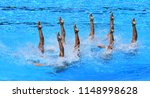 synchronized swimmers point up...   Shutterstock . vector #1148998628