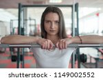 serious fitness girl looking at ... | Shutterstock . vector #1149002552