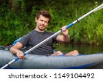 a young man rowing of paddle in ... | Shutterstock . vector #1149104492
