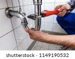 Male plumber's hand repairing...