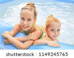 girls swimming in the pool. ... | Shutterstock . vector #1149245765