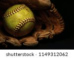 A Yellow Softball In An Old ...