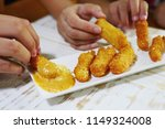 people eating cheese stick many ... | Shutterstock . vector #1149324008