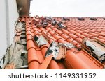old moldy roof tile being... | Shutterstock . vector #1149331952