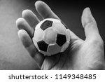 hand hold a small soccer ball   ... | Shutterstock . vector #1149348485