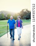 senior couple holding hands and ... | Shutterstock . vector #1149357212