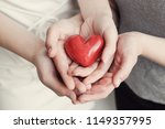 young woman holding red heart ... | Shutterstock . vector #1149357995