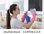 young woman cleaning microwave... | Shutterstock . vector #1149361115