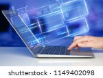 hand using laptop with database ... | Shutterstock . vector #1149402098