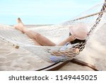 young woman resting in hammock... | Shutterstock . vector #1149445025