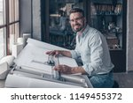 smiling architect at work in... | Shutterstock . vector #1149455372