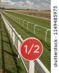 Small photo of 1/2 Furlong sign at an English Racecourse.