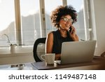 young african woman working at... | Shutterstock . vector #1149487148