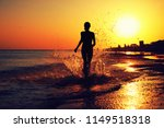 girl walking on water along the ... | Shutterstock . vector #1149518318