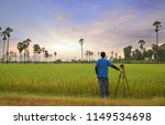 photographer man stand with... | Shutterstock . vector #1149534698